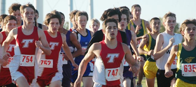 Cross country runners — including Tonganoxie High's David Powell, Dalton Lawson and Matt Brock — jockey for position in the opening stage of the Kaw Valley League championship on Thursday at the Tonganoxie cross country course.