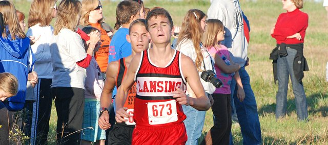 Bonner Springs' Brooks Ballou was right on Brandon Craig's shoulder early, but soon Craig, a Lansing High junior, pulled away and cruised to his second straight Kaw Valley League cross country championship.