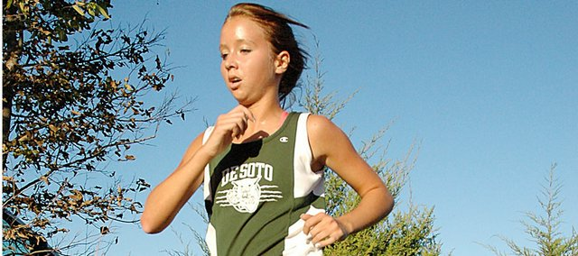 De Soto's Ellie Sheridan sprints down the home stretch of the Gardner cross country course Thursday afternoon en route to her victory in the varsity girls' 4-kilometer race. Sheridan finished in a time of 15:47 to lead the Wildcats to a runner-up finish at the Frontier League meet.