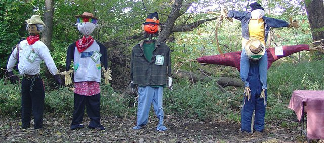 Crows were too scared to approach during this year's Autumn in the Grove activities, thanks in large part to these scarecrows built by Lansing schoolchildren.