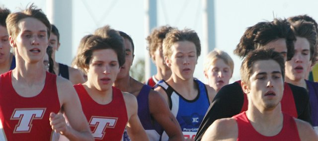 THS cross country runners David Powell, Dalton Lawson and Matt Brock get moving in the opening stage of the KVL championship on Thursday at the Tonganoxie cross country course. All three seniors finished in the top 30.