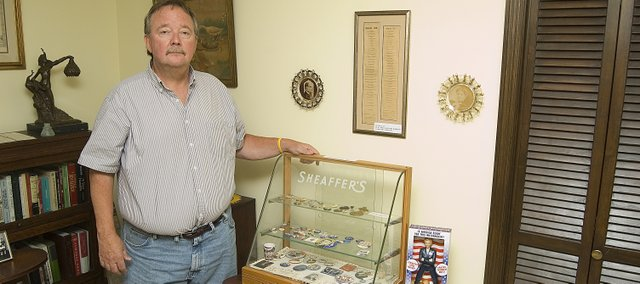 Bill Peak, Tonganoxie, stands near his collection of political buttons in his Tonganoxie home. Peak collects political memorabilia and has seen several presidential candidates give speeches through the years. He and his wife also travel to homes and gravesites of former presidents.