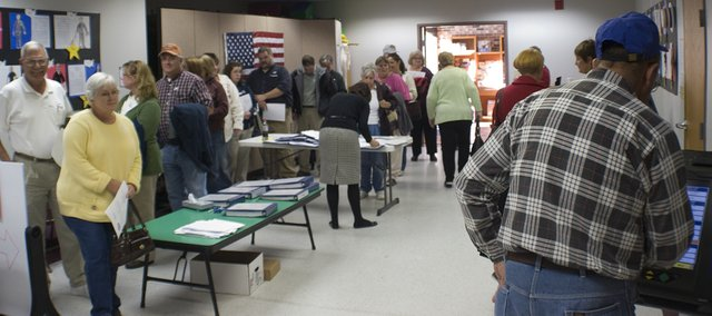 A line starts to form at the Tonganoxie Public Library as Leavenworth County residents prepare to cast their advance ballots in the 2008 general election early. More than 2,870 people have taken advantage of advance voting. The satellite polling station will be open between 1-7 p.m. Oct. 29 at the Basehor Community Library, 1400 158th St..