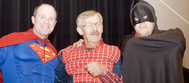 Posing as superheroes Superman, Spiderman and Batman for the Tonganoxie High School Aim for Excellence assembly on Friday at the Tonganoxie Performing Arts Center are assistant principal Brent Smith, industrial arts teacher Don Schaeffer and principal Jamie Carlisle.