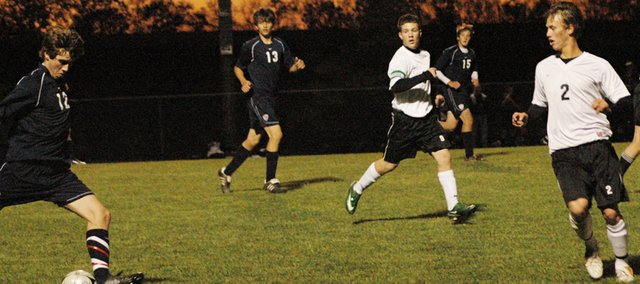 Jordan Slater defends against a St. James pass Tuesday night at De Soto. The Thunder defeated the Wildcats, 1-0, in overtime to end the Wildcats season.