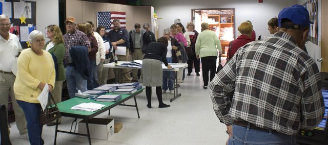 A line starts to form at the Tonganoxie Public Library as Leavenworth County residents prepare to cast advance ballots in the 2008 general election. More than 2,870 people have taken advantage of advance voting in the county.