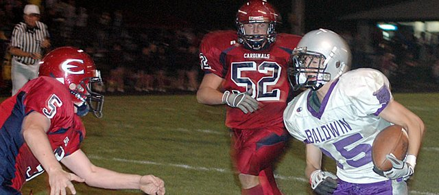 Baldwin High School senior Andy Thurlow, right, runs around several Eudora defenders Thursday night. Thurlow scored Baldwin's first touchdown of the night. Baldwin lost the game 35-28, but will play at Bishop Miege Tuesday night.