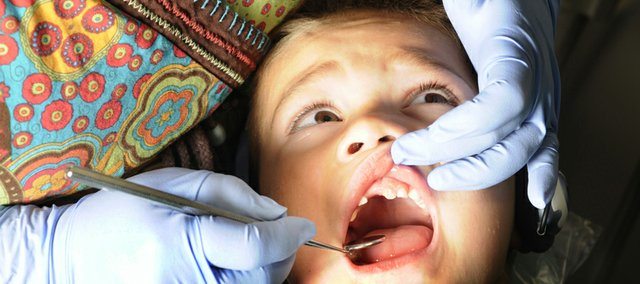 Ben Delgado, 4, of Eudora, was getting his teeth cleaned at Growing Smiles, at 1425 Wakarusa on Wednesday. Many parents are watching their children's teeth this time of year, with Halloween close at hand and lots of sweets being given out.