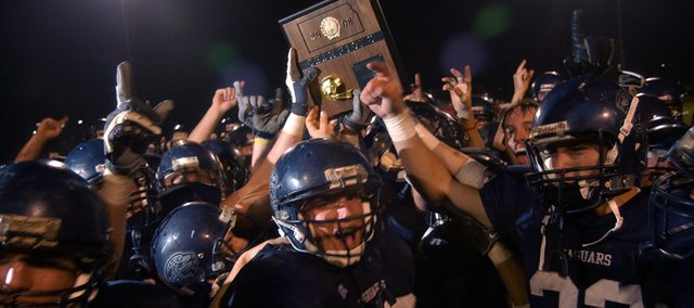 The Mill Valley Jaguars celebrated their 21-14 win Friday over Lansing to clinch the District and League championship.