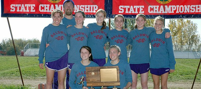 Baldwin High School's girls' cross country team won its second straight Class 4A state championship Saturday at Wamego. Kneeling in the front row are seniors, from left, Calleigh Durr and Corinna Papps. Back row are sophomore Heather Karlin, coach Mike Spielman, junior Julie Hill, junior Connor Twombly, freshman Abi Hartzell, junior Misty Emery and freshman Elizabeth Sigvaldson.