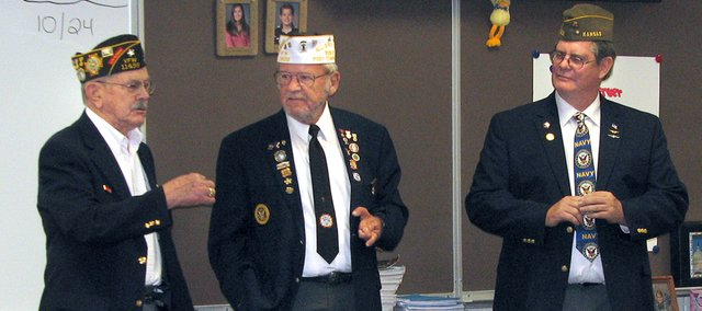 Basehor Veterans of Foreign Wars members (from left) Wilbur Grisham, Fred Box and Dan Stueckemann talk to fifth-graders Friday afternoon at Basehor Elementary School in preparation for Veterans Day.