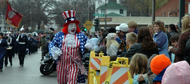A clown greets spectators Tuesday morning during Leavenworths 89th annual Veterans Day parade. More than 200 organizations participated in the parade, which is the oldest in the country.