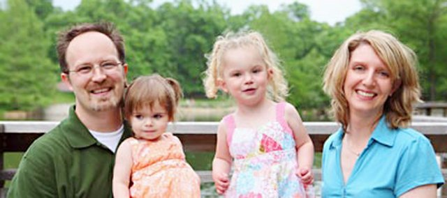 Chris, Elorah, Isabelle and Amanda Ellis pose for a picture. Three-year-old Isabelle passed away Thursday night at  St. Louis Children's Hospital while awaiting a heart transplant.
