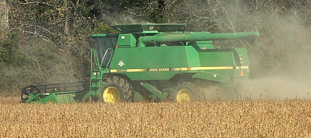 Area farmers, such as Todd Dwyer, shown here near Vinland, have been harvesting corn and soybeans recently. While the harvest has gone well, the prices aren't so good.
