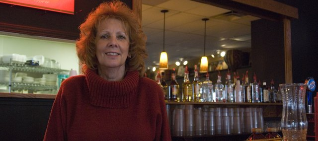 Jo Yazel, owner of Pastimes Bar and Grill in Basehor — located at Basehor Town Square — stands behind the bar of the new establishment, which she operates with her son, Toby Yazel.