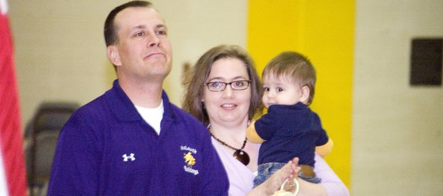 Shawn, Gretchen and Wyatt Miller are recognized Thursday morning at McLouth High during a special ceremony.