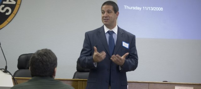 Will Katz, director of the Kansas University Small Business Development Center,  addresses local small business owners on Thursday at the Tonganoxie City Council chambers. Katz spoke at a roundtable discussion — sponsored by the Tonganoxie Chamber of Commerce — regarding the challenging economy.