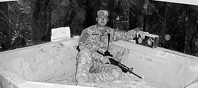 Sgt. Tyler Trowbridge, Baldwin City, sits in an ornate bathtub in a palace once occupied by Iraqi dictator Saddam Hussein. Trowbridge is back in the States, but wonders if his service overseas is finished.