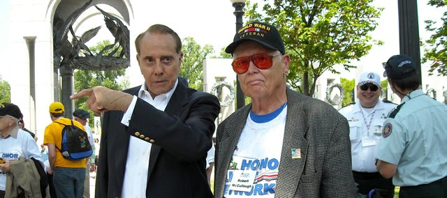 Former U.S. Sen. Bob Dole chats with World War II and Korean War veteran Robert McCullough of Tonganoxie on May 3 during McCullough's visit to the National World War II Memorial.