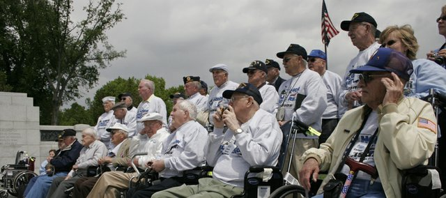 World War II veterans from Kansas listen during a ceremony at the World War II Memorial in Washington, D.C. They are pictured during an April 30 Honor Flight to the memorial.