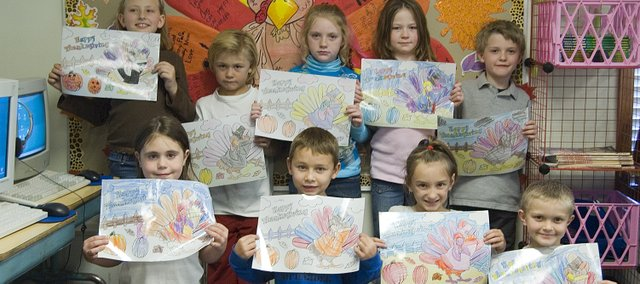 "Students in Kathy Link's second-grade class at Genesis Christian Academy made ""Happy Thanksgiving"" placemats for pen pals at Tonganoxie Nursing Center. Front row, from left, are Ashley Gallagher, Brett Ingeron, Taylor Lynne and Salem Clemens; back row, from left, Kiles McConnaughey, Asher Robbins, Jill McMacklin, Samantha Stewart and Alex Christian."