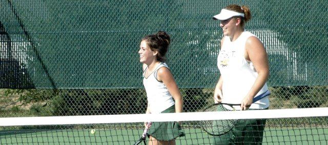 De Soto's No. 1 doubles tennis team of Hana Lindbloom and Suzie Gulley are all smiles after winning a match earlier this season. Gulley and Lindbloom finished fifth at state this year.