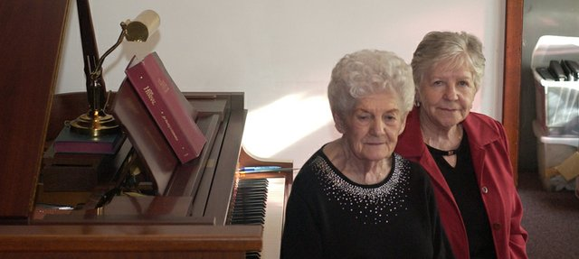 Gladys Danelenko of Bakersfield, Calif., and Anna Lo Lathem of Springfield, Mo., sit at the grand piano gifted to the De Soto Baptist Church through the will of their sister Mary Lou Simmons, who with her husband, Kenny, who were part of the congregation for more than 50 years. In addition to other leadership positions in the Church, the couple were active in the choir.