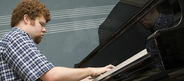 Greg Rogers practices a Beethoven sonata before his piano lesson. Rogers, who has been blind from birth, is majoring in business at Baker University, but he is getting a minor in music.