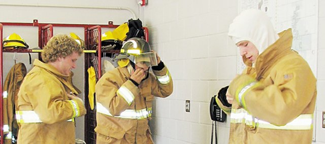 Fairmount Township firefighter cadets practice changing into their gear. The cadets must be able to do so in less than 60 second to be able to go on a fire call.
