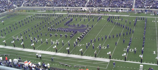 The Kansas State University Marching Band performs during a recent college gameday in Manhattan. Within the K-S-U formation is Tonganoxie High School graduate Kezia Huseman, who also was a member of the 2007-08 K-State pep band, which played at Wildcat home games.