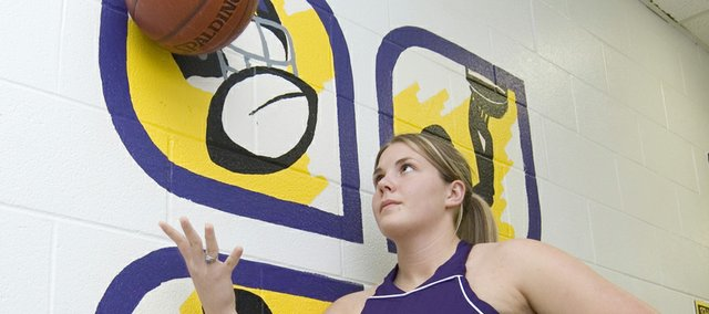 Haley Holwick is embracing her role as the lone senior on the McLouth High girls basketball team this year.