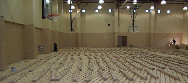 Crews work during November 2007 on the gymnasium floor of the Eudora Community Center. Vanum Construction Company alleges it still is owed more than $120,000 for its work on the aquatic and community centers.