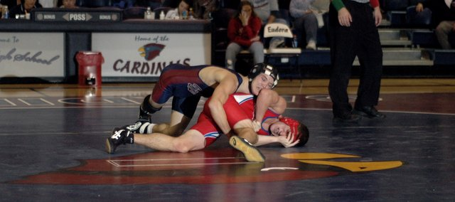Alex Tacke wrestles against his Santa Fe Trail opponent Tuesday night at Eudora. Tacke led early but lost the match. The Cardinals defeated the Chargers 34-30 in their season opening dual.