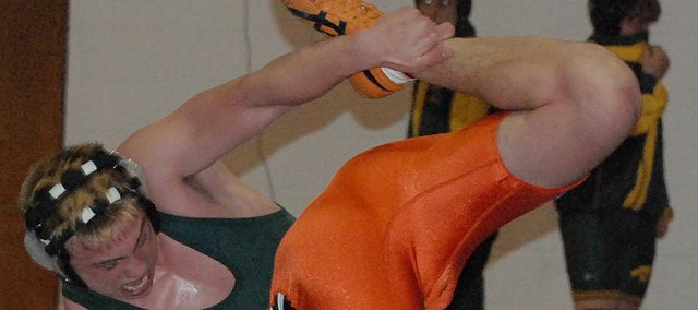 Basehor-Linwood&#39;s Chandler King, left, tangles with Bonner Springs&#39; Anthony Ellingsworth during their match at 171 pounds on Tuesday.