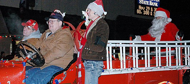 Santa Claus made his usual entry into downtown Baldwin City during Saturday night's annual Holiday Light Parade aboard an antique fire truck.