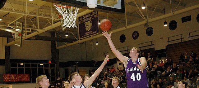 Baldwin High School junior Zach Wright (No. 40) skies above his teammates for a layup Thursday night during the Bulldogs' preseason scrimmage. Both BHS varsity teams begin their seasons at home Tuesday night.