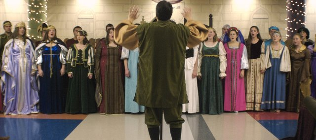 Tom Gifford, THS vocal instructor, directs the Chieftain Singers during the 2008 Madrigal Feaste.