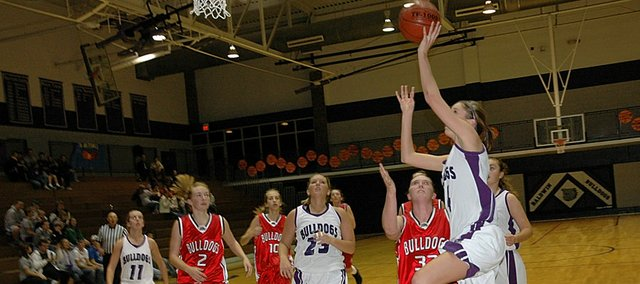 Baldwin High School sophomore Ramie Burkhart, right, attempts a layup Tuesday night as Baldwin defeated Anderson County 45-30 to begin the season 1-0. The BHS boys' team also won Tuesday, winning 51-46.