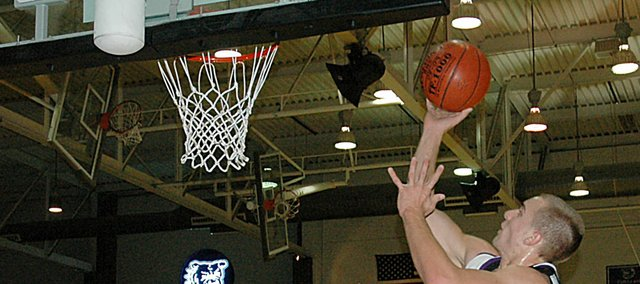 Baldwin High School senior Clad Kueffer scores two of his 19 points Tuesday night as BHS defeated Anderson County 51-46 to begin the season 1-0.