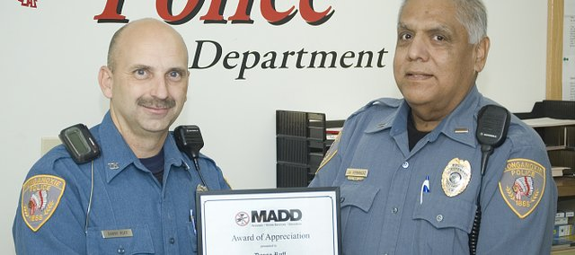Tonganoxie Police officer Danny Ruff, left, receives a Mothers Against Drunk Driving award from Lt. Tony Hernandez for his work in issuing driving under the influence citations.