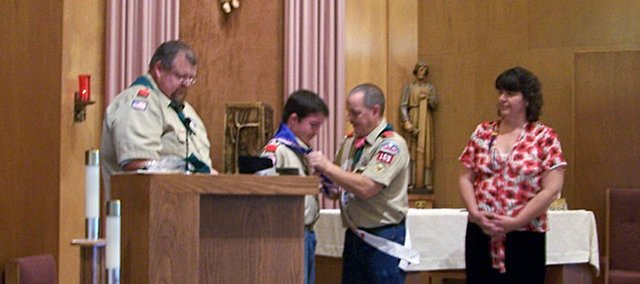 Basehor resident Alec R. Smith receives his Eagle Scout Award on Nov. 2, 2008.