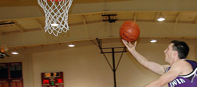 Baldwin High School senior Chris Hecker drives in for a layup Tuesday night. Hecker scored six points in the Bulldogs 48-35 victory over the Eagles.
