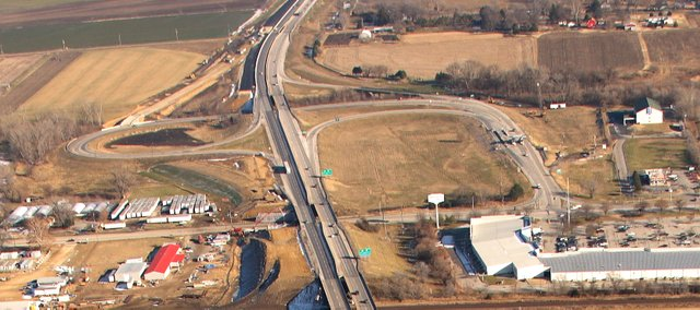 This is an aerial view, taken Dec. 11, looking east across the Kansas Turnpike's East Lawrence interchange. By the end of the month, crews plan to close the interchange's existing ramp for traffic coming into town from the east. A new ramp, in the upper left of the photo, will carry traffic for more than a year.
