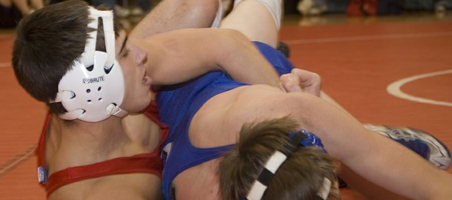 Tonganoxie High senior wrestler Matt Brock (140) grapples in the fifth round of the Randy Starcher Memorial Invitational on Saturday at THS. Brock was one of four Chieftains to finish first as an individual as THS won the team title.
