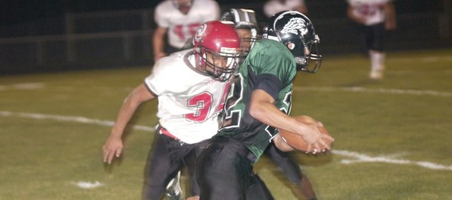 Mark England runs for a big gain against Ottawa on homecoming. England scored a touchdown in the Wildcats' 33-7 win. The Wildcats began the year 0-4 but fought back and won four straight, played for a district championship and made the playoffs for the first time in four years.
