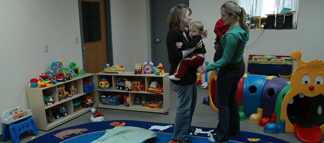 Shelly Snyder, left, and Sara Snyder, co-owners of All About Kids daycare, work with Tonganoxie twins, Terrick and Tayden Trobough, 2, after their nap. The new daycare facility is located at K-7 and Donahoo.