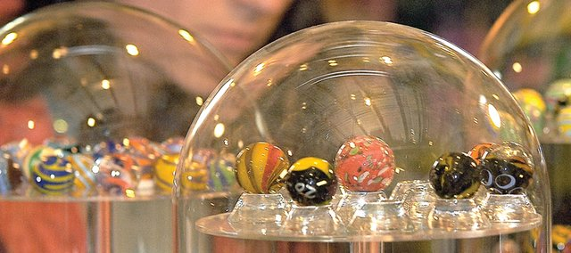 Glass dome display cases show off multicolor marbles offered to shoppers and browsers alike at Moon Marble, 600 E. Front St. Moon Marble is one of 24 finalists in the Kansas Sampler Foundation's 8 Wonders of Kansas Commerce competition.