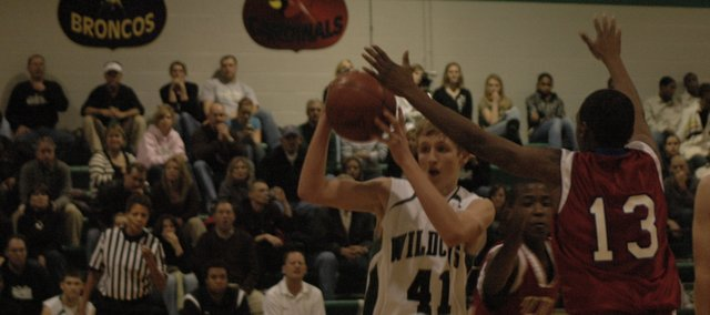 Brandan Philbrook looks for an open teammate against Wyandotte Tuesday night at De Soto. The Wildcats hit eight threes in the game and defeated the Bulldogs 51-45.