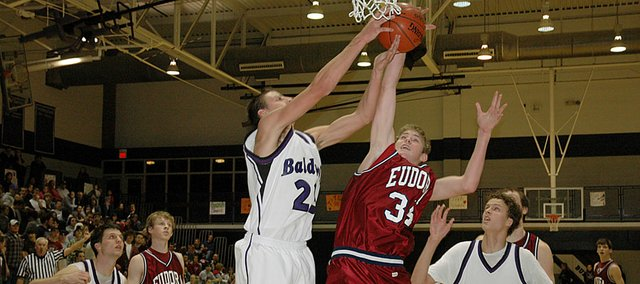 Baldwin High's Brandon Tommer (No. 23) battles Eudora's Drew Noble (34) for a rebound during the second half of Friday's Frontier League contest. Eudora won in overtime, 47-45.