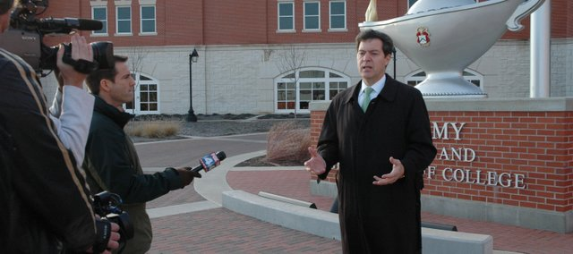 U.S. Sen. Sam Brownback speaks with reporters in front of the Lewis and Clark Center at Fort Leavenworth following a press conference he gave in December concerning the transfer of enemy combatants from Guantanamo Bay to the base. Brownback this week invited President-elect Barack Obama to the fort to see firsthand why the combatants shouldn't be confined at the U.S. Disciplinary Barracks.